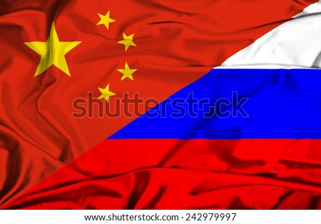 Waving flag of Russia and China - stock photo