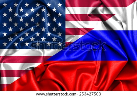 Waving flag of Russia and USA - stock photo