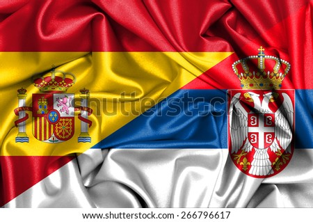 Waving flag of Serbia and Spain - stock photo