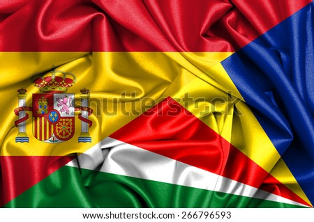 Waving flag of Seychelles and Spain - stock photo