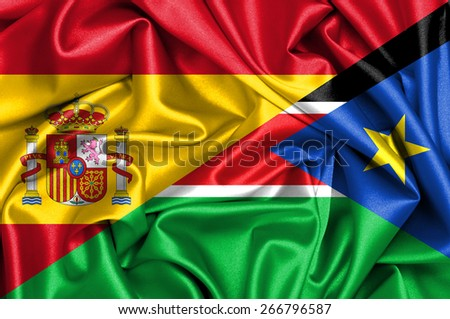 Waving flag of South Sudan and Spain - stock photo