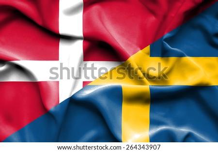 Waving flag of Sweden and Denmark - stock photo