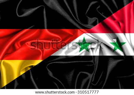 Waving flag of Syria and Germany - stock photo