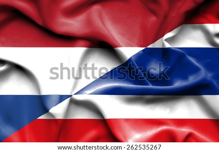 Waving flag of Thailand and Netherlands - stock photo