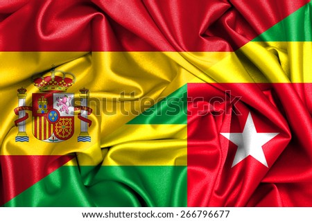 Waving flag of Togo and Spain - stock photo