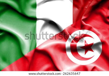 Waving flag of Tunisia and Italy - stock photo