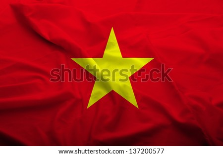 Waving flag of Vietnam. Flag has real fabric texture. - stock photo