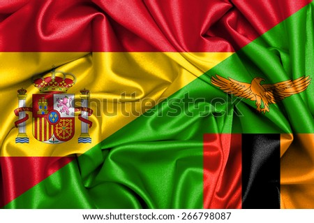 Waving flag of Zambia and Spain - stock photo