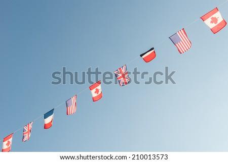 Waving flags WW II, Allied Landing, Normandy, France - stock photo