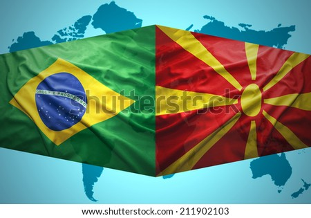 Waving Macedonian and Brazilian flags of the political map of the world - stock photo
