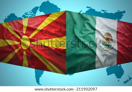 Waving Macedonian and Mexican flags of the political map of the world - stock photo