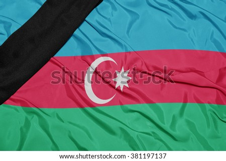 waving national flag of azerbaijan with black mourning ribbon  - stock photo