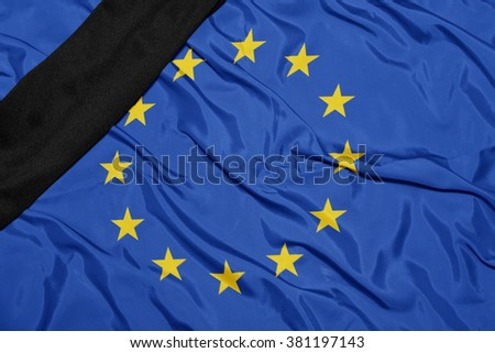 waving national flag of  with black mourning ribbon  - stock photo