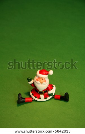 Waving Santa Claus does the splits with copy space - stock photo