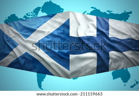 Waving Scottish and Finnish flags of the political map of the world - stock photo