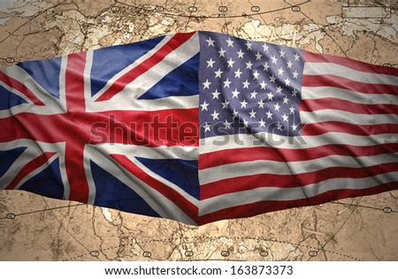 Waving United States of America and British flags on the background of the political map of the world - stock photo