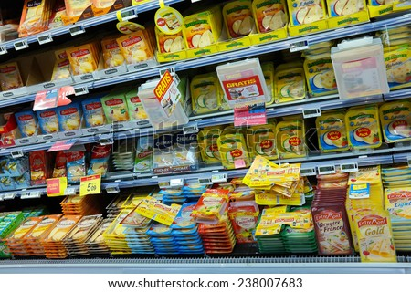 WAVRE, BELGIUM - OCTOBER 17: Refrigerated shelves with cheese at a Carrefour Hypermarket. What is the price trend after the milk quota abolition in 2015?. taken on October 17, 2014 in Wavre, Belgium - stock photo