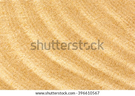Wavy sample of beach sand as background - stock photo