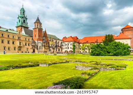 Wawel Cathedral in Krakow, Poland. Green lawn against the castle - stock photo