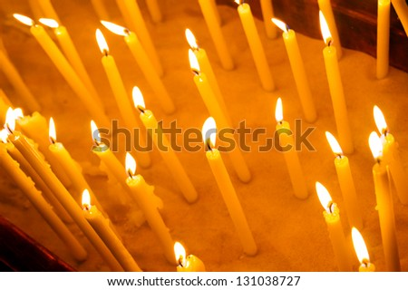 Wax candles in the sandy candlestick - stock photo