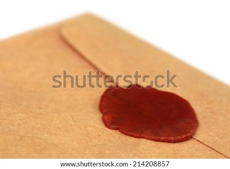 Wax seal on brown envelope over white background - stock photo