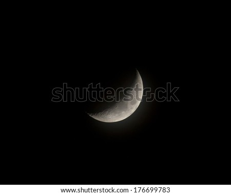Waxing Crescent moon with mist, showing craters - stock photo