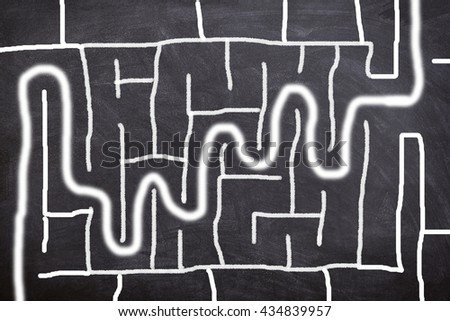 way out of maze game on chalkboard - stock photo