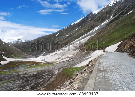 Way to a distant mountain peak in the Himalayan region of Ladakh - stock photo