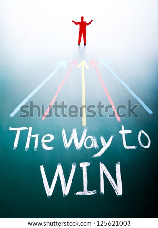 Way to win concept, man and words on blackboard - stock photo