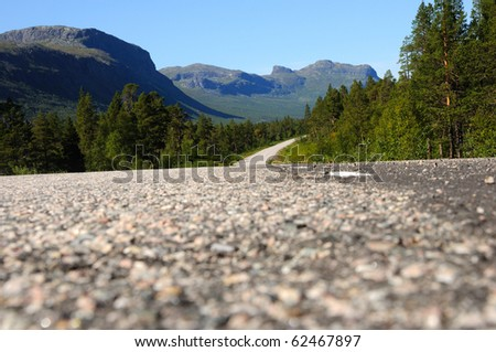 way up to the mountains. the road leading up to Ritsem in northern Sweden - stock photo