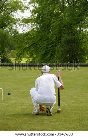 Waying up which way to play the croquet match - stock photo