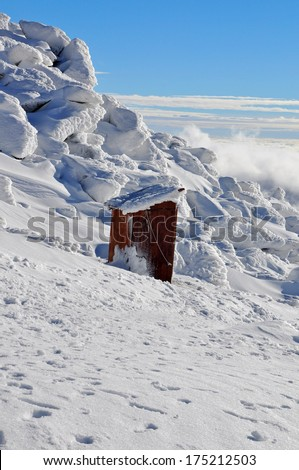 wc in the mountains  - stock photo