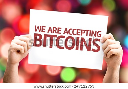 We Are Accepting Bitcoins card with colorful background with defocused lights - stock photo