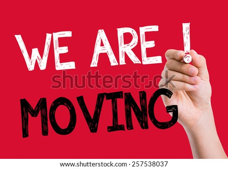 We Are Moving written on the wipe board - stock photo