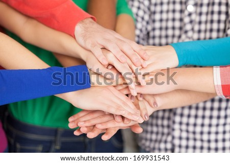 We are strong when we together. Close-up of many hands clasped together - stock photo