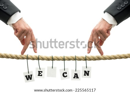 We Can Concept Design - Human Hand on Rope with Hanging We Can Text, Isolated on White Background. - stock photo