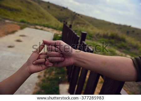 We close the little finger, we prove that a good commitment - stock photo