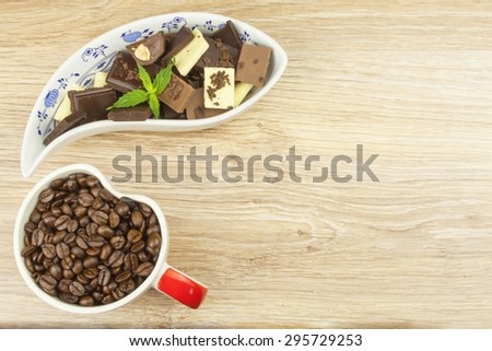 We love coffee and chocolate. Chocolate and coffee on a wooden table. Sweet treat with coffee. - stock photo