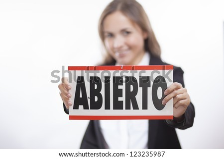 We're open for business and we speak Spanish - stock photo