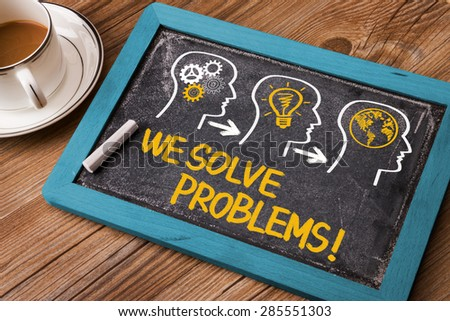 we solve problems concept on blackboard - stock photo