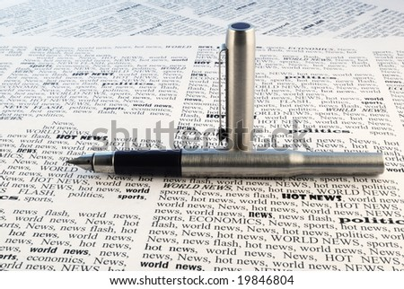 we take all news, fountain-pen above a newspaper closeup - stock photo