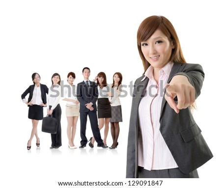 We want you, Asian business woman point at you in front of her team isolated on white background. - stock photo