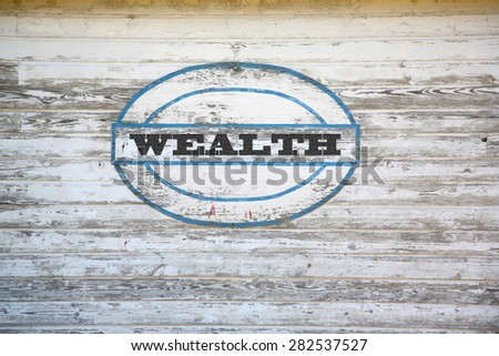Wealth Concept - Wealth sign on shed side - stock photo