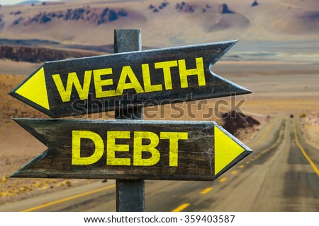 Wealth - Debt signpost in a desert background - stock photo