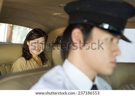 Wealthy Woman in Chauffeur Driven Limousine - stock photo