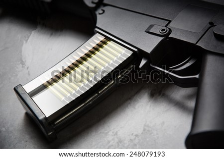 Weapon loaded with pencils - stock photo