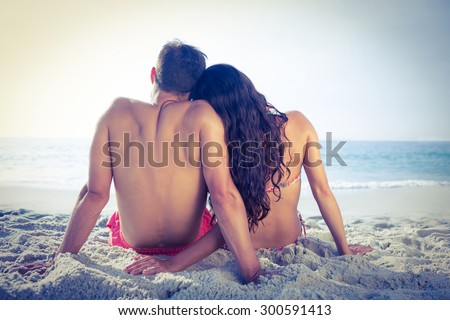 Wear view of couple hugging at the beach - stock photo