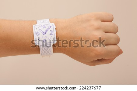 wearable technology - thin hand made paper watch - stock photo