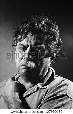 weary middle-aged man, black and white - stock photo