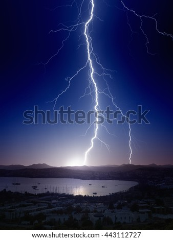 Weather background - bright powerful lightning, huge thunderbolt struck mountain near small seaside city - stock photo